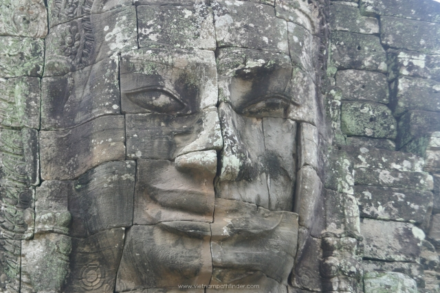 smile stutue buddha on bayond temple in Siemreap