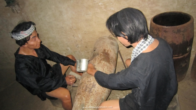 VC is cutting bomb in Cu Chi Tunnels during war year to get bomb powder